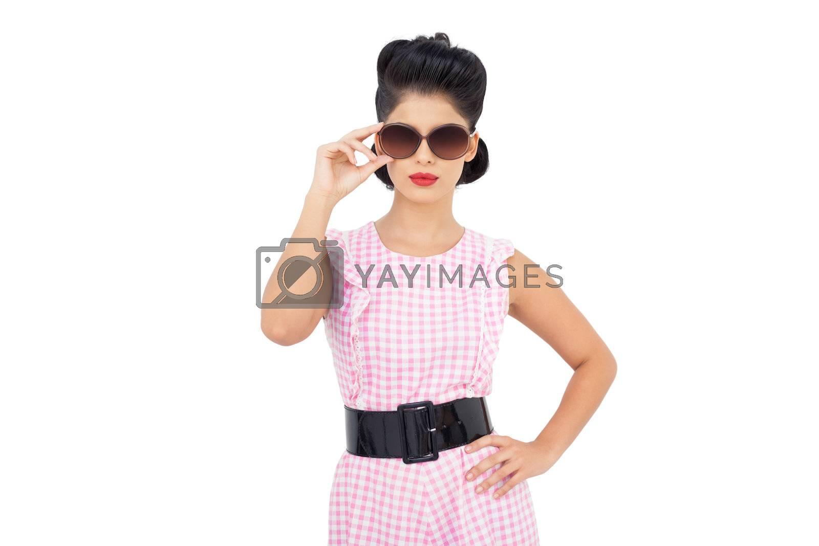 Pretty black hair model wearing sunglasses by Wavebreakmedia
