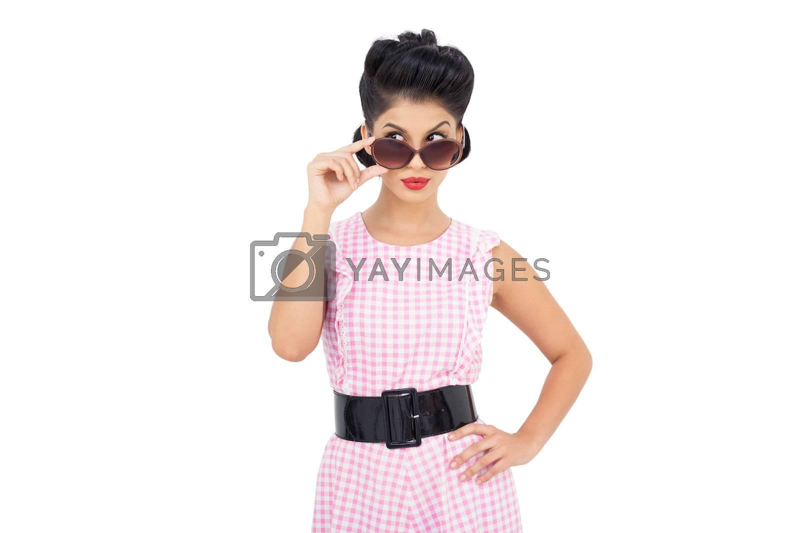 Playful black hair model looking over her sunglasses by Wavebreakmedia