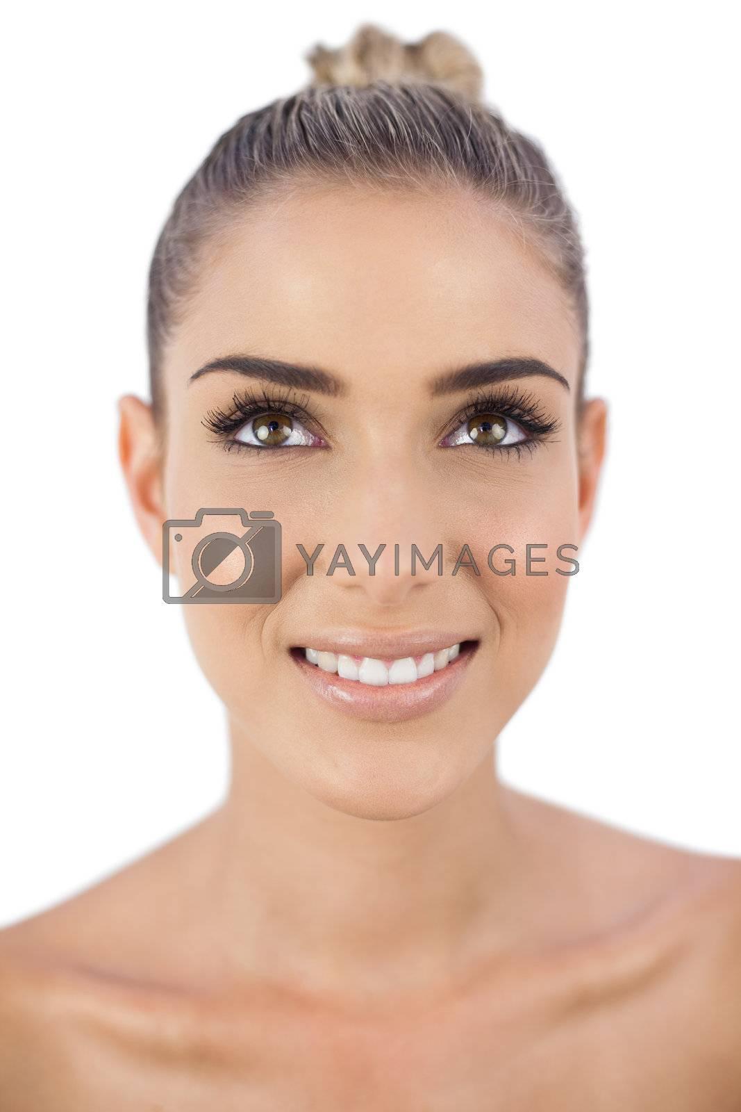 Cheerful woman looking away by Wavebreakmedia