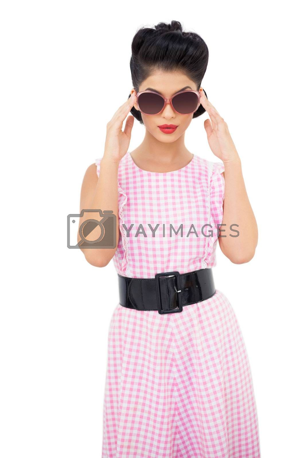 Lovely black hair model wearing sunglasses by Wavebreakmedia