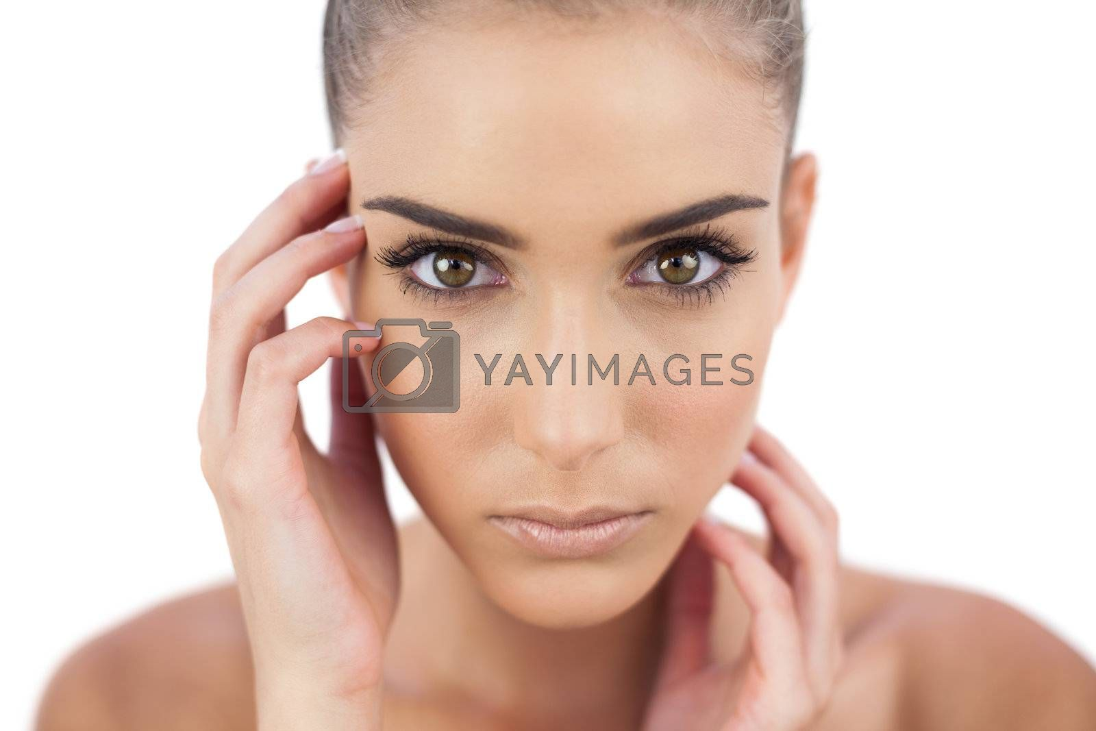 Close up of a serious woman looking at camera by Wavebreakmedia