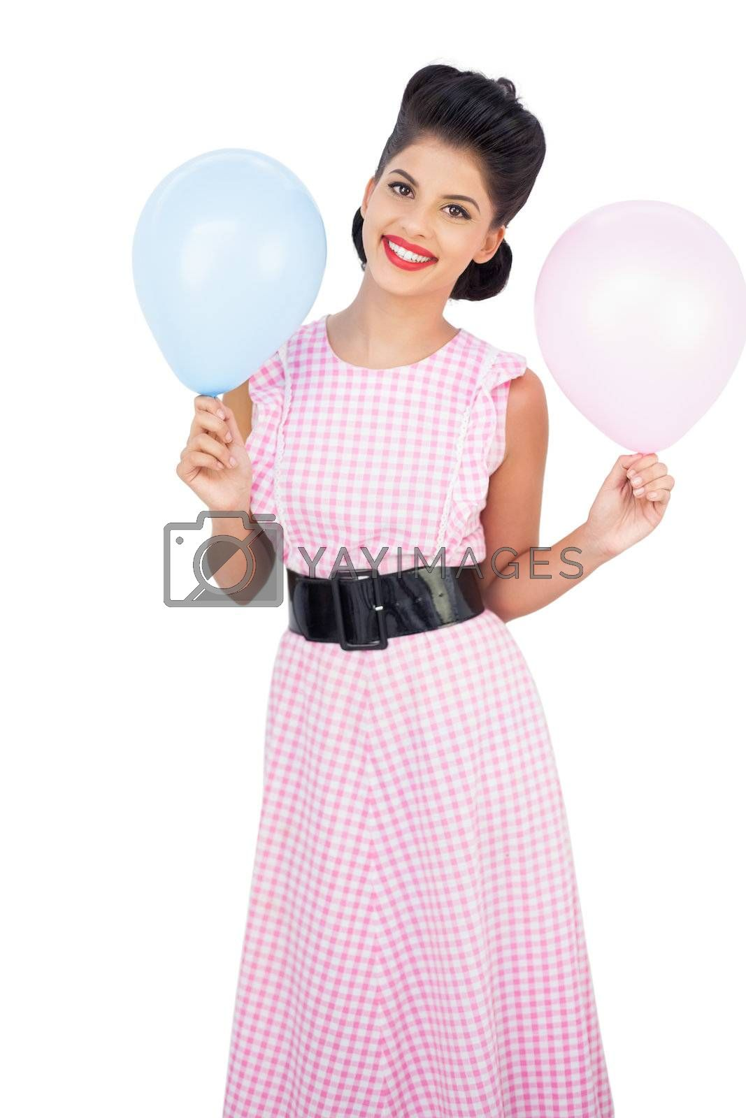 Cheerful black hair model holding balloons by Wavebreakmedia