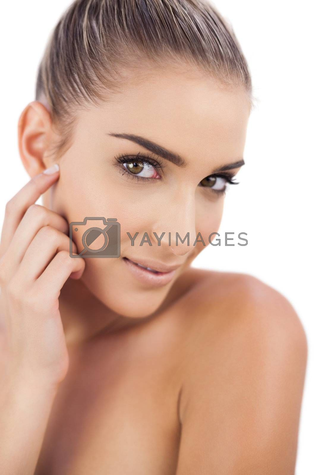 Lovely woman looking at camera by Wavebreakmedia