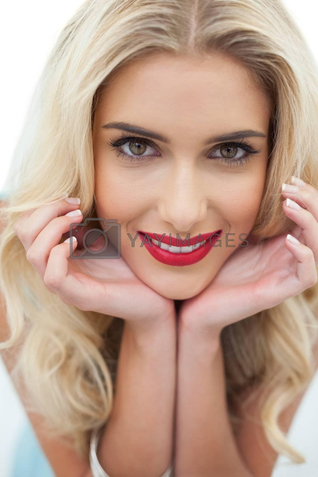 Close up of smiling blonde model looking  by Wavebreakmedia