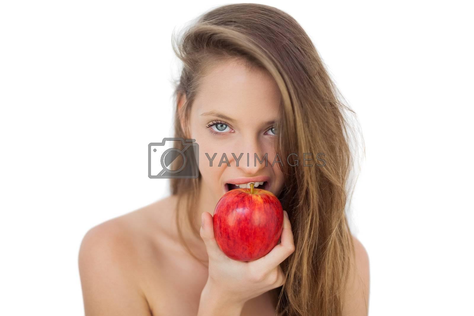 Pretty brunette model eating an apple by Wavebreakmedia