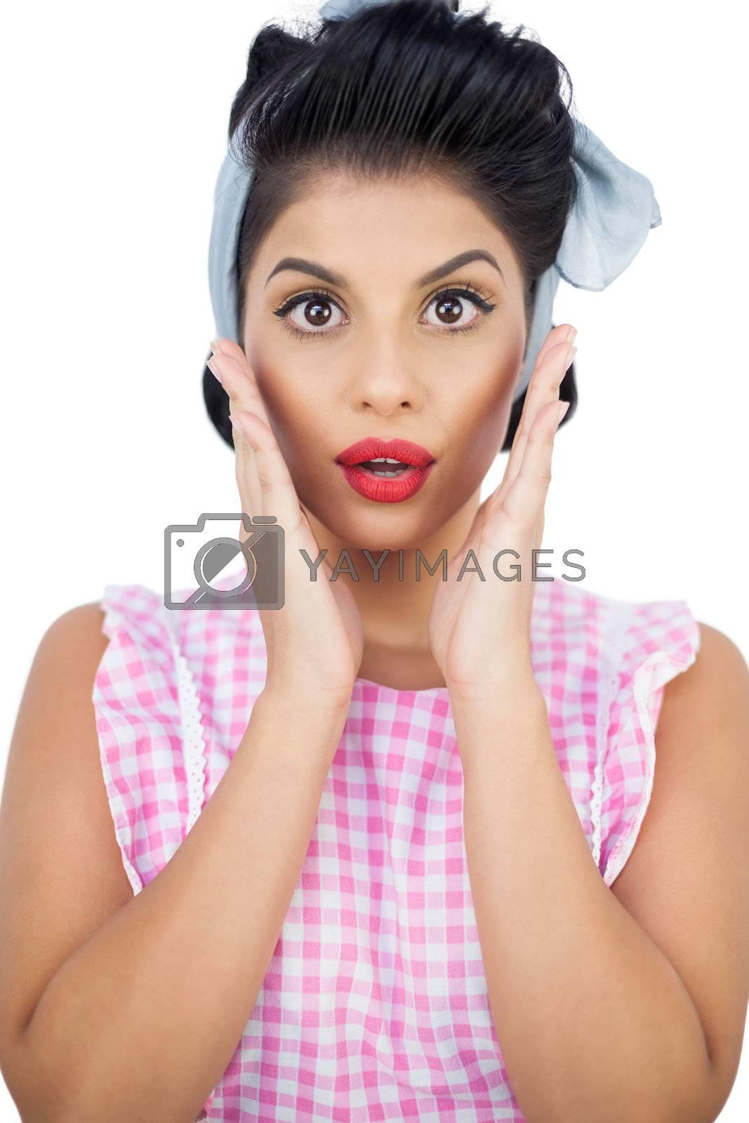 Surprised black hair model posing and raising her hands by Wavebreakmedia