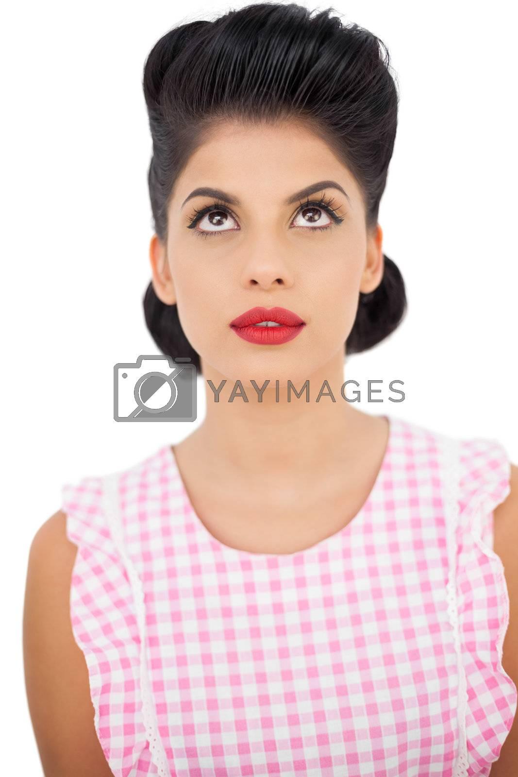 Gorgeous black hair model looking up by Wavebreakmedia