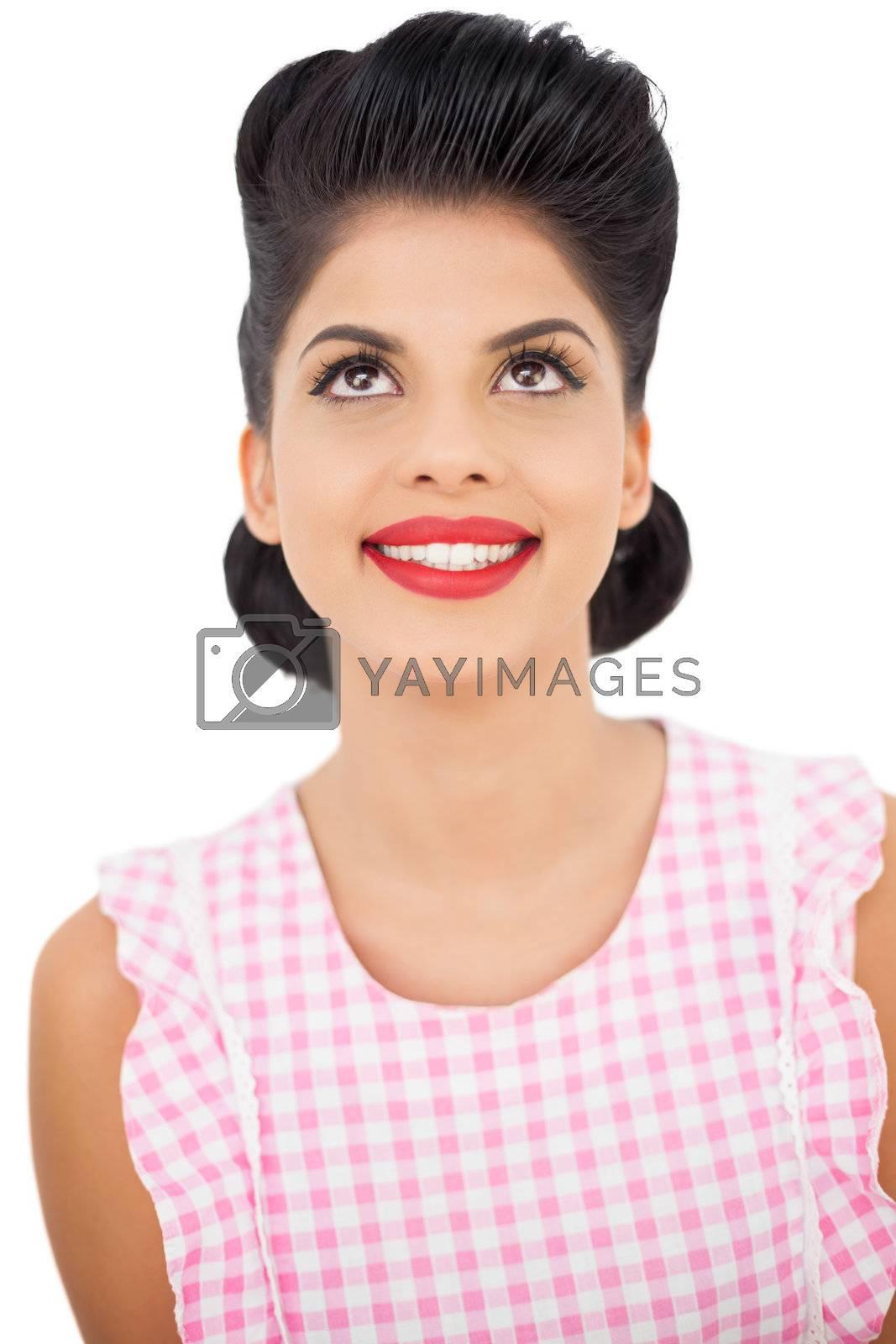 Smiling black hair model looking up by Wavebreakmedia