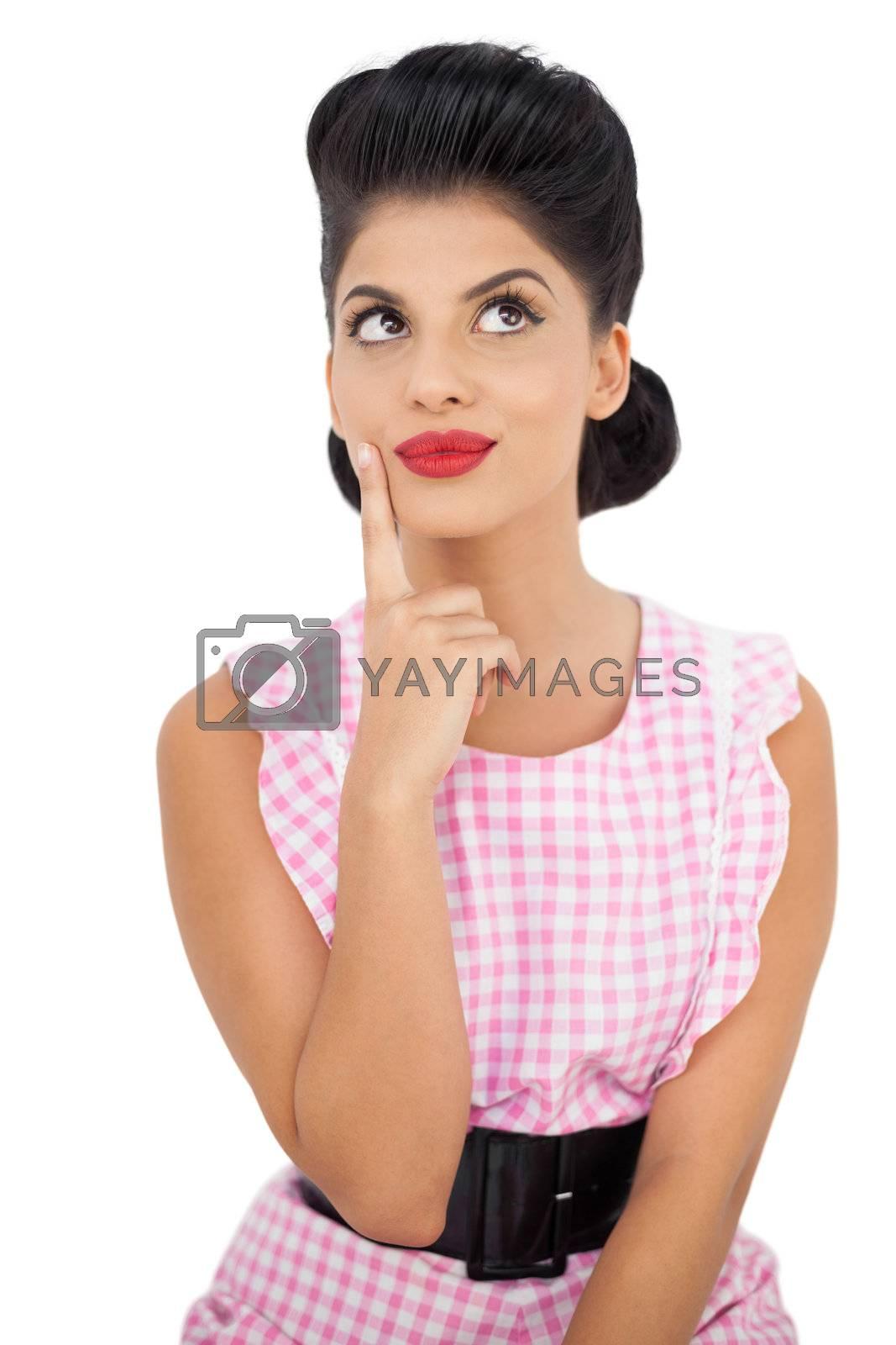 Satisfied black hair model looking away by Wavebreakmedia
