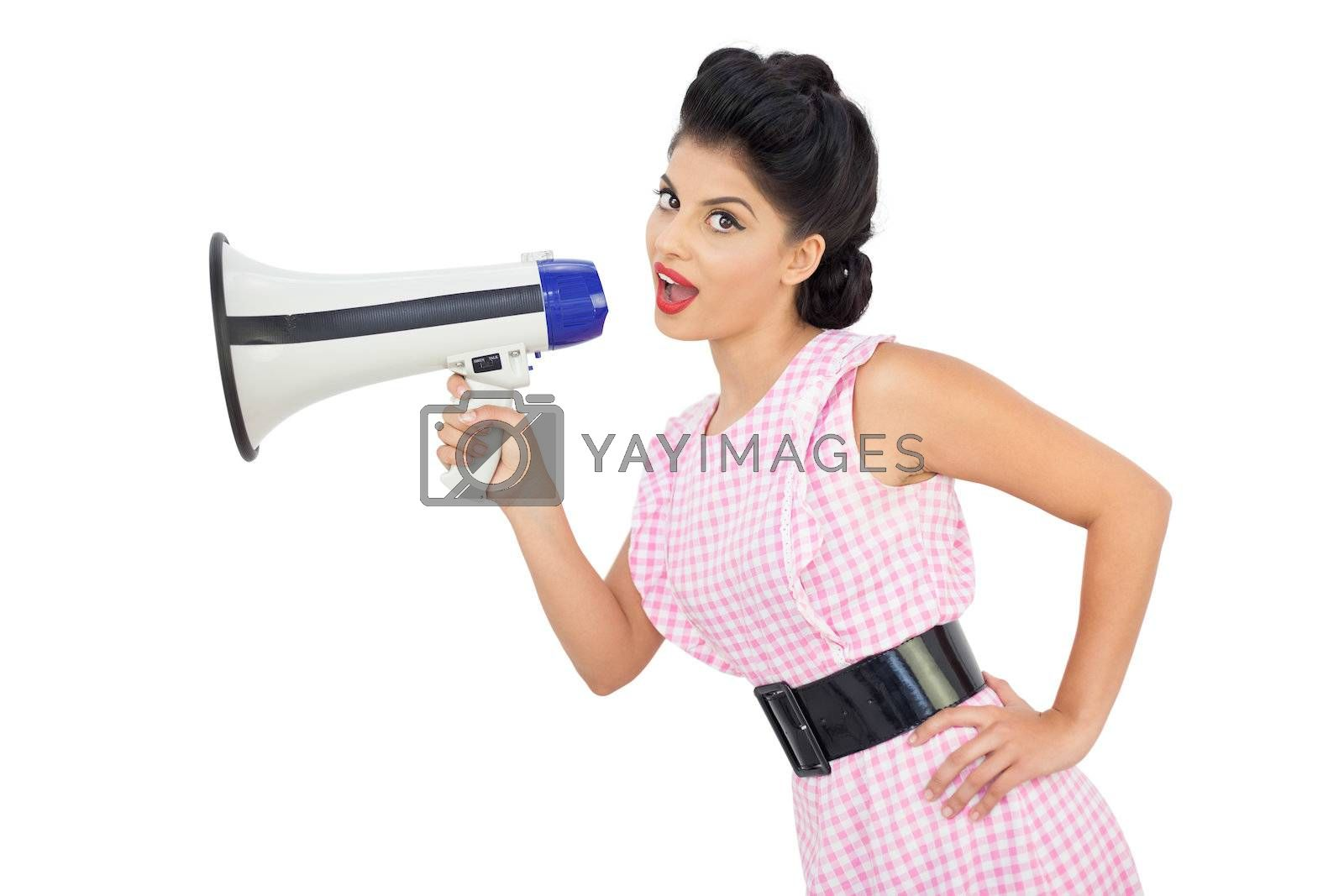 Attractive black hair model using a megaphone by Wavebreakmedia