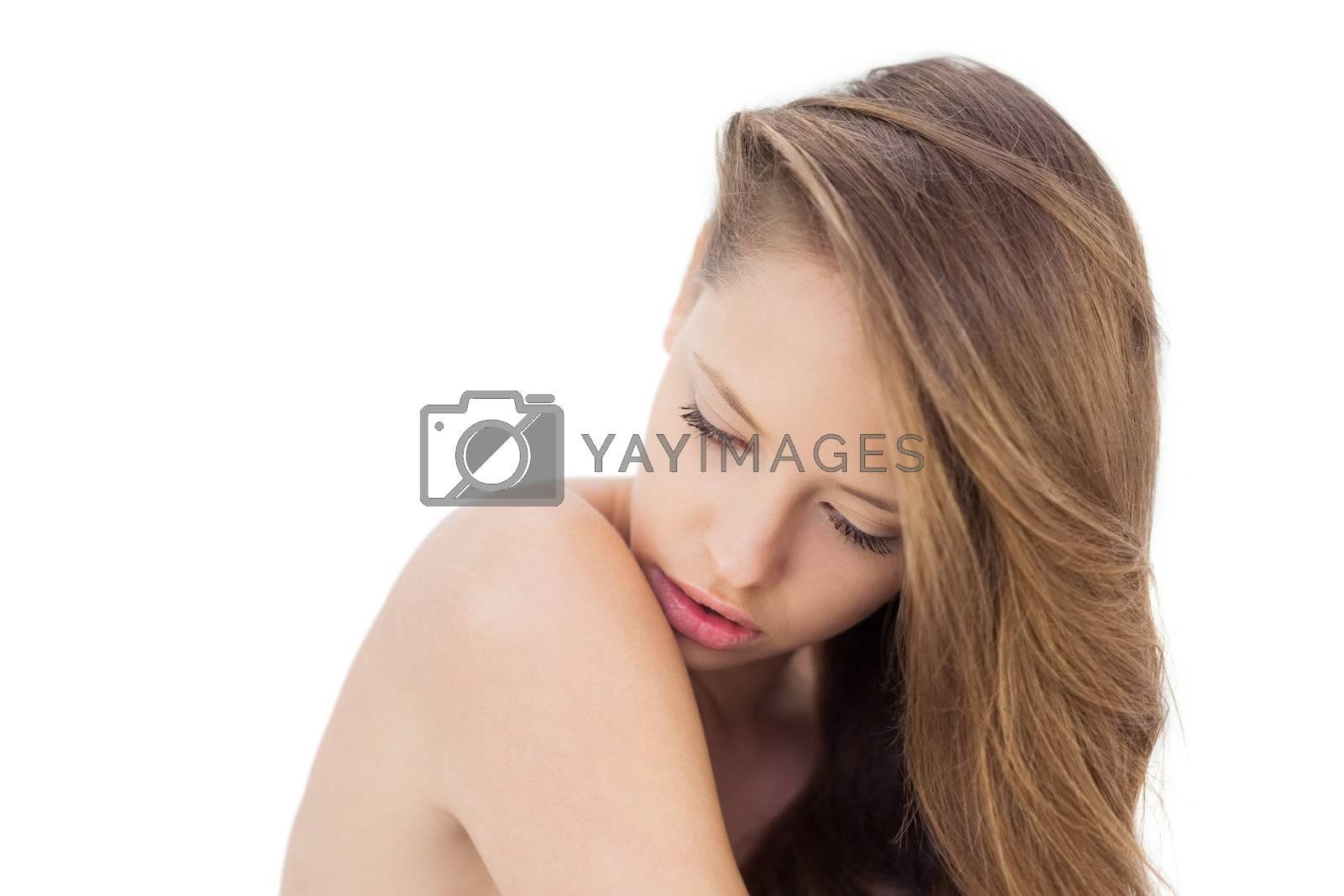 Calm brunette model posing looking her shoulder by Wavebreakmedia