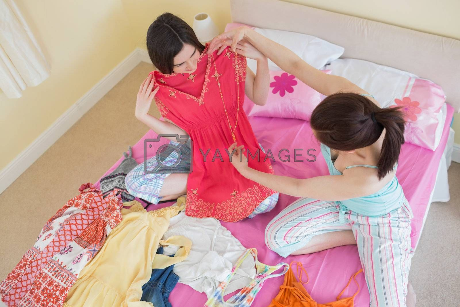Cute girls looking at a dress at a sleepover by Wavebreakmedia