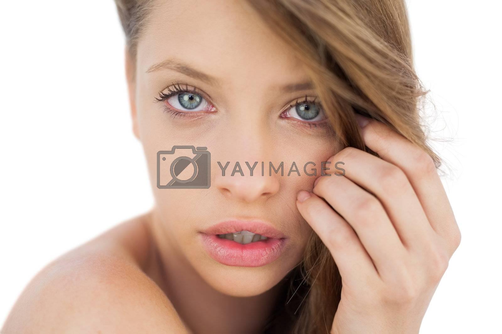 Anxious brunette model posing looking  by Wavebreakmedia