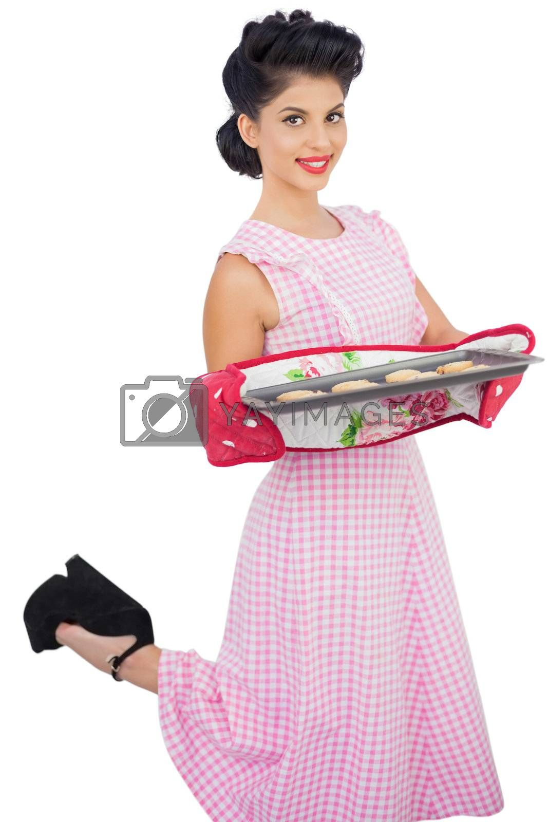 Content black hair model holding baking tray of cookies by Wavebreakmedia