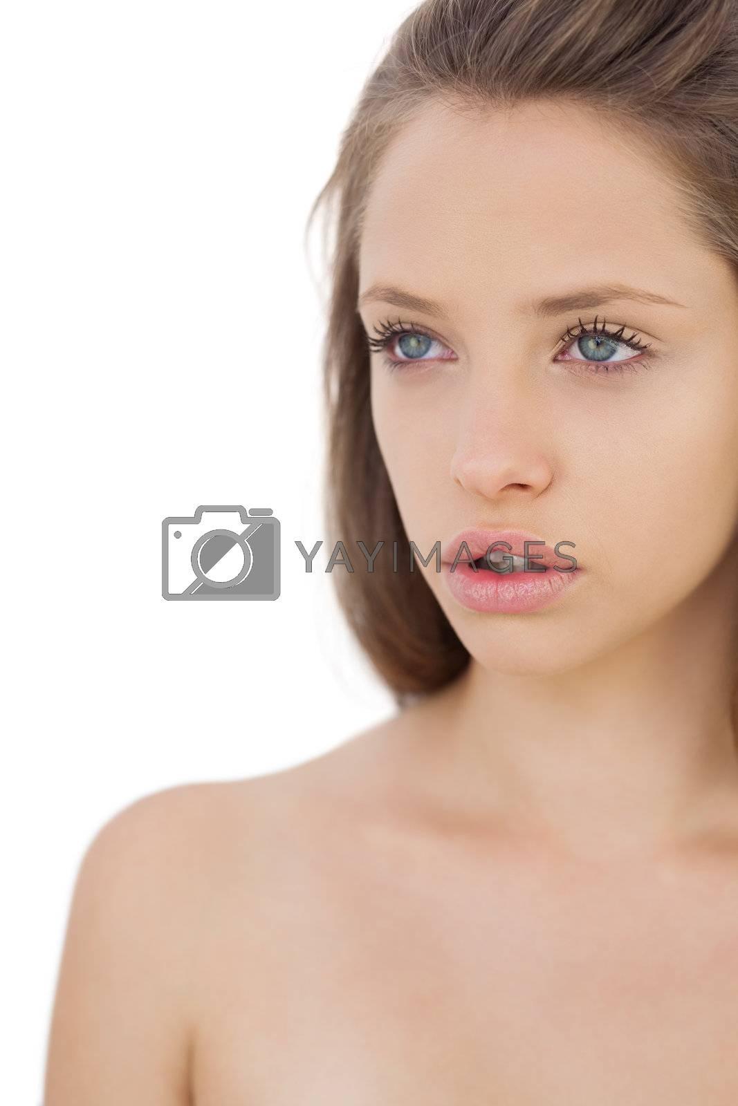 Thoughtful brunette model looking away by Wavebreakmedia