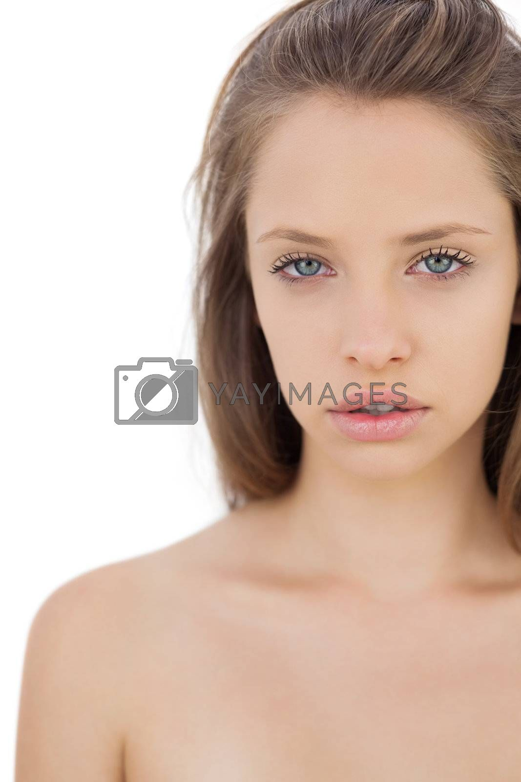Thoughtful brunette model looking at camera by Wavebreakmedia
