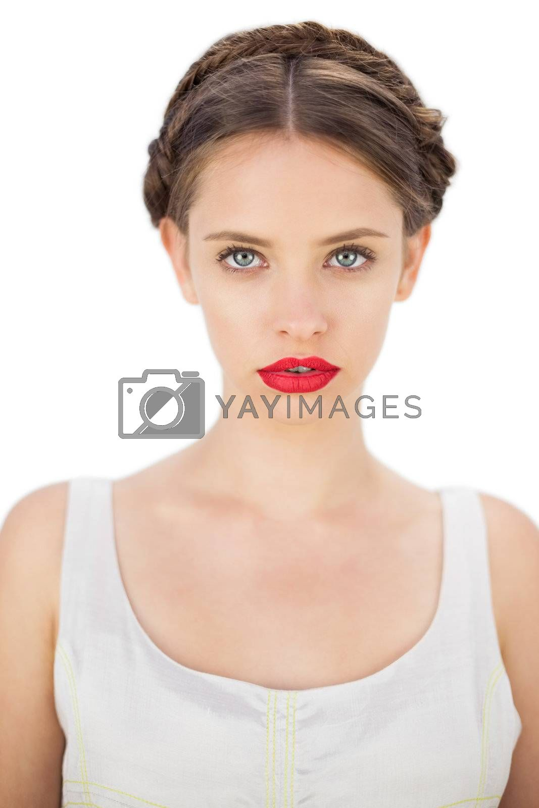 Glamour model in white dress posing looking at camera by Wavebreakmedia