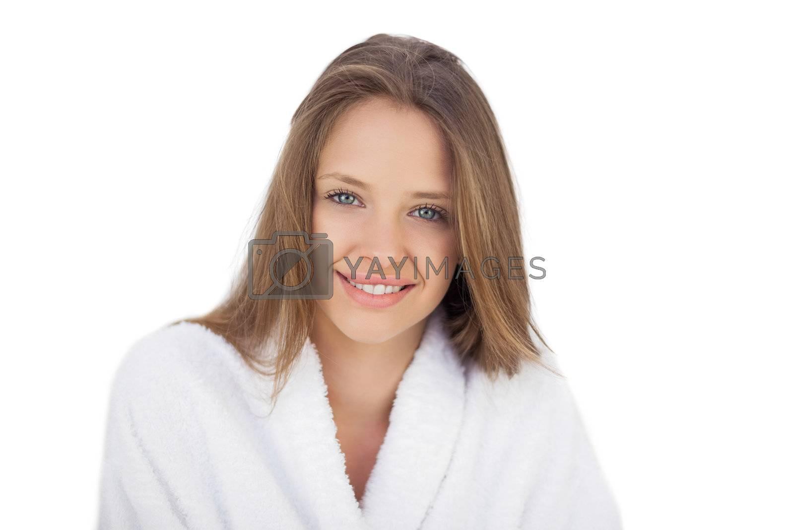 Smiling brunette in bathrobe looking  by Wavebreakmedia