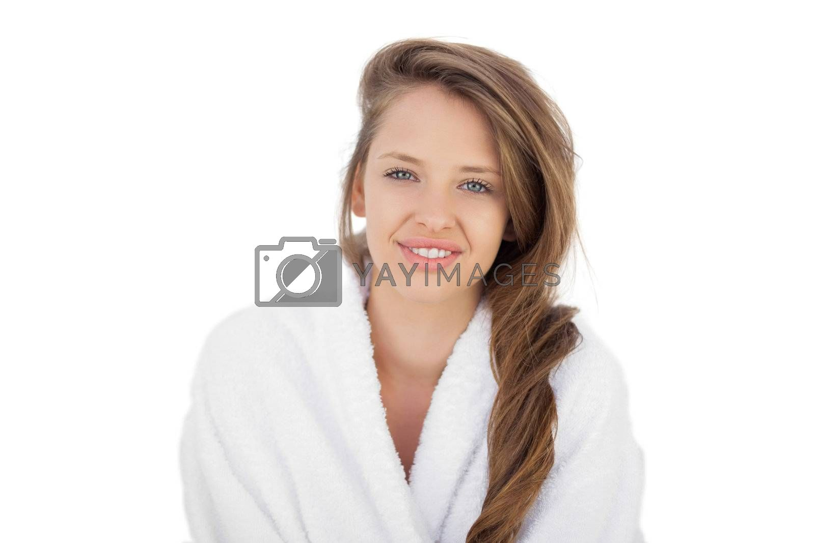 Delighted brunette in bathrobe looking  by Wavebreakmedia
