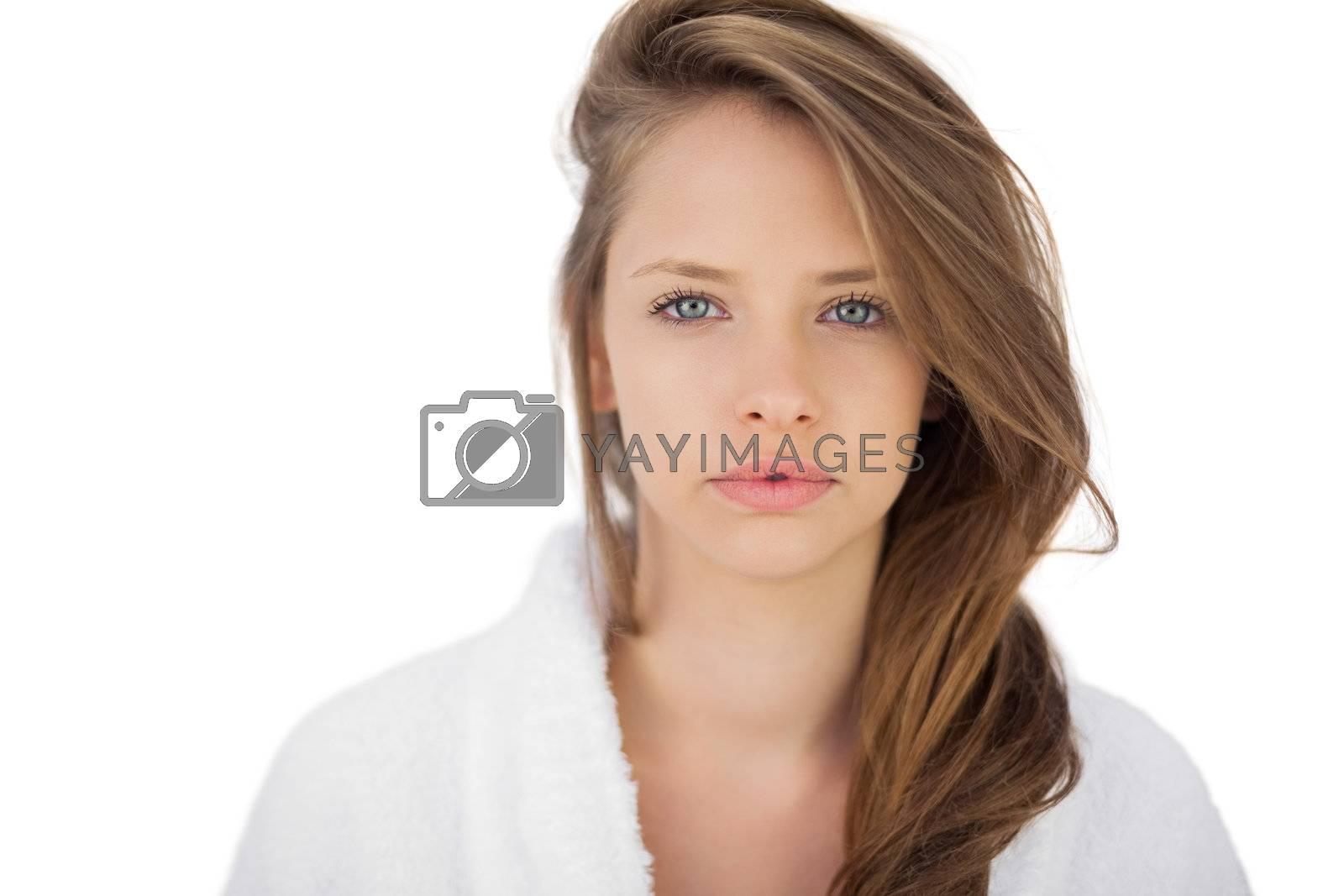 Wondering brunette in bathrobe looking at camera by Wavebreakmedia