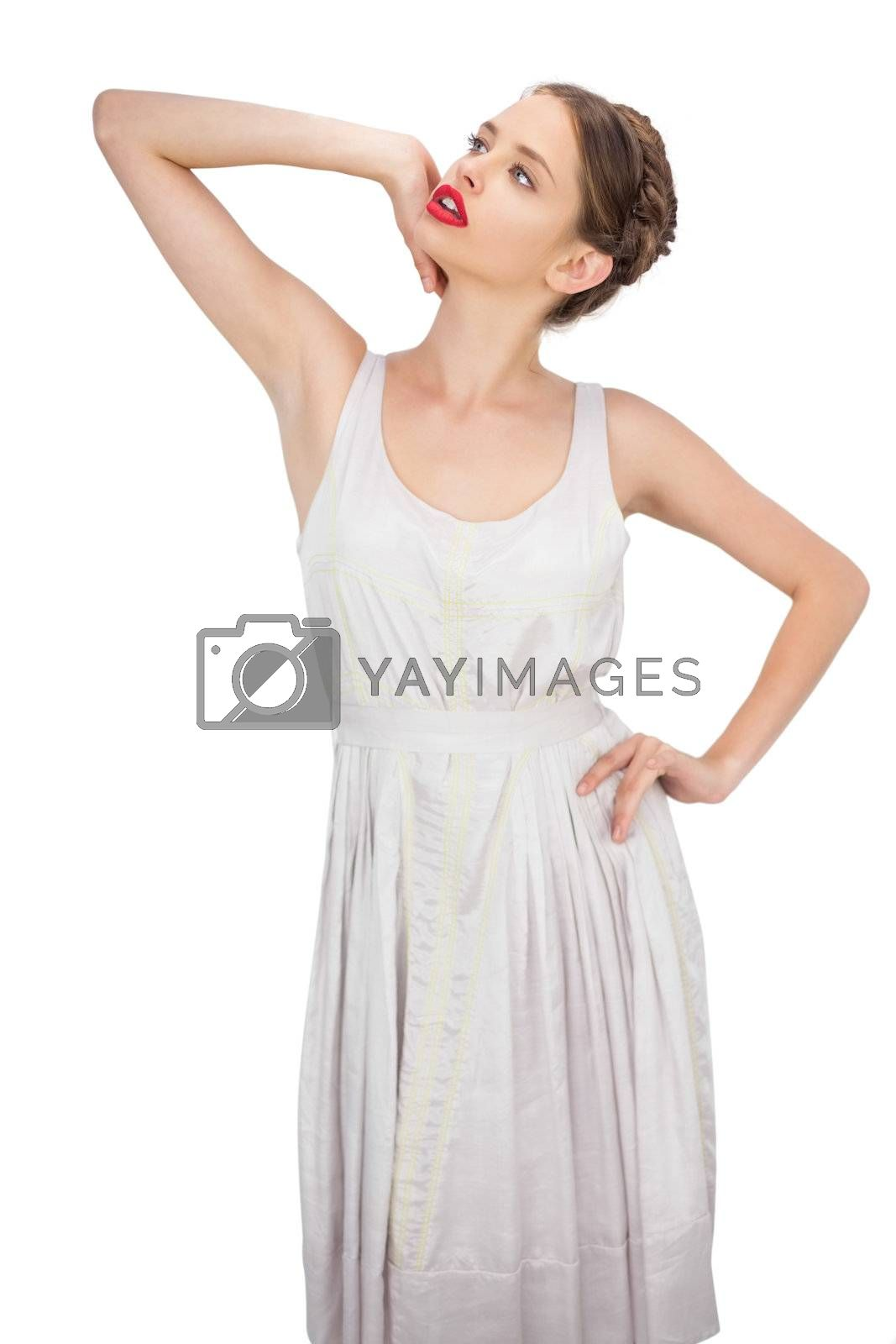 Sensual model in white dress posing looking away by Wavebreakmedia