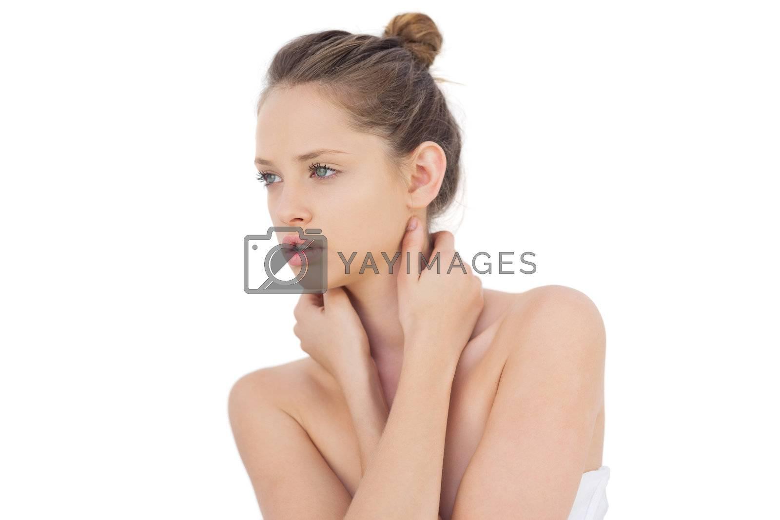 Natural brunette model posing looking away by Wavebreakmedia