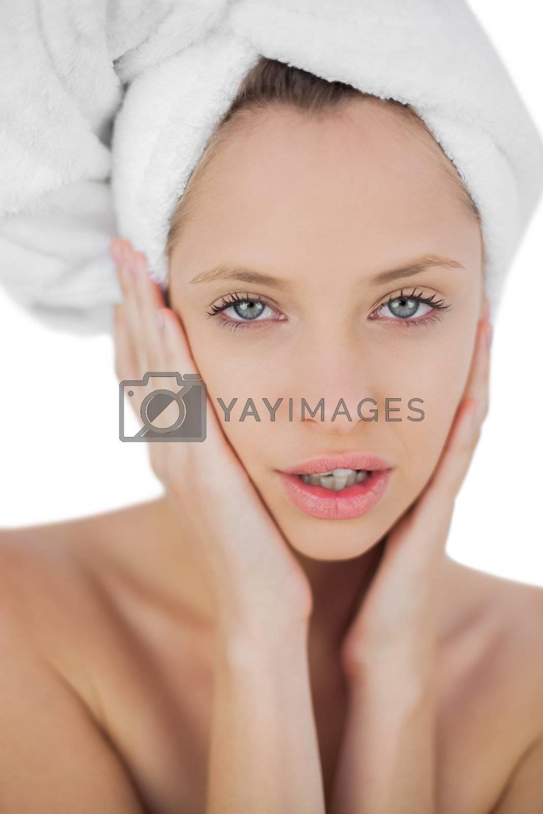 Thinking brunette drying her hair looking  by Wavebreakmedia