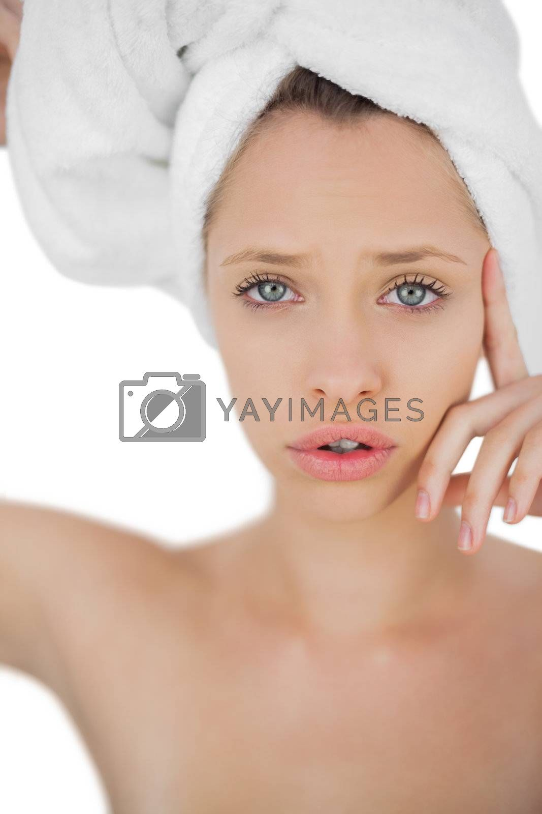 Unsmiling brunette drying her hair looking at camera by Wavebreakmedia