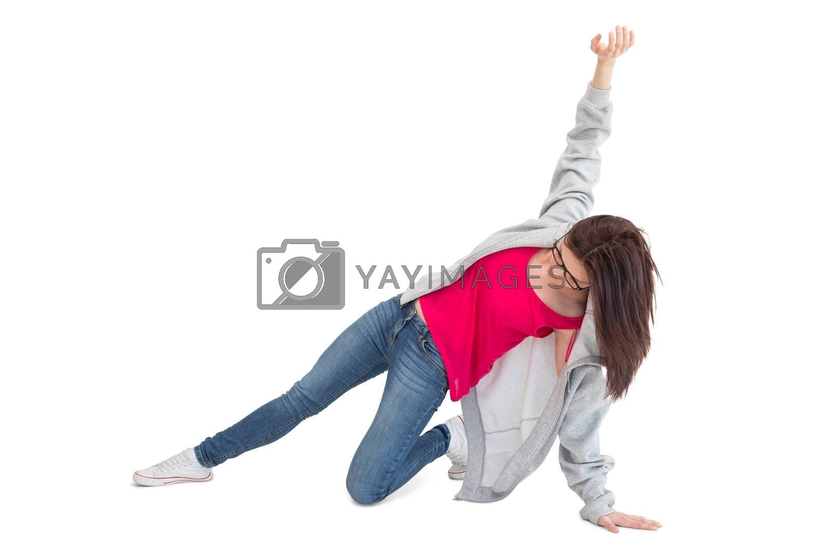 Pretty young woman making hip hop pose by Wavebreakmedia