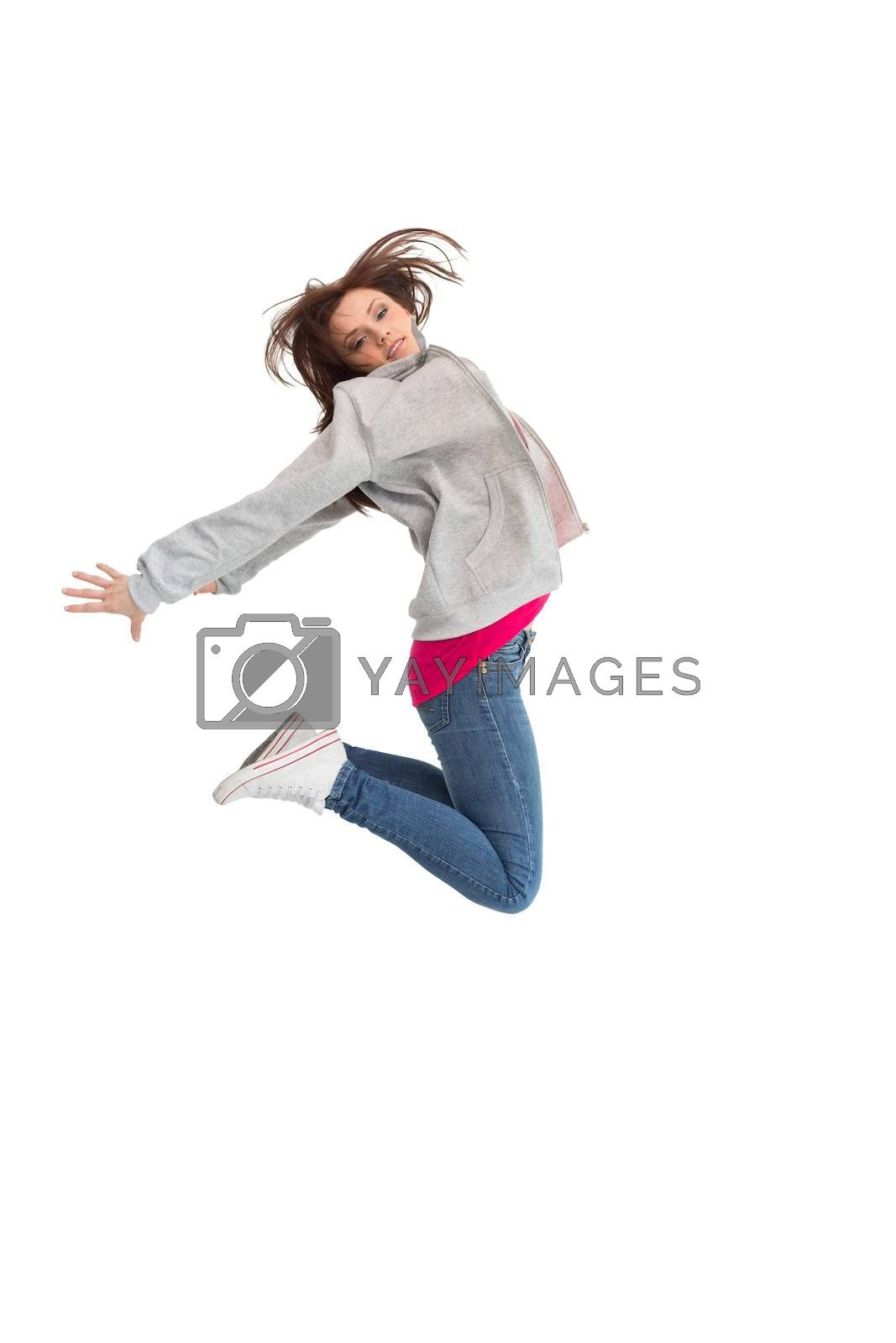 Pretty young woman jumping by Wavebreakmedia