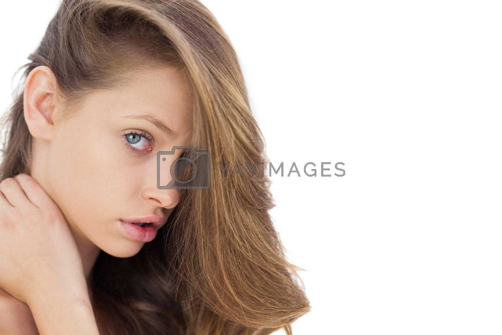 Charming brunette posing looking at camera by Wavebreakmedia