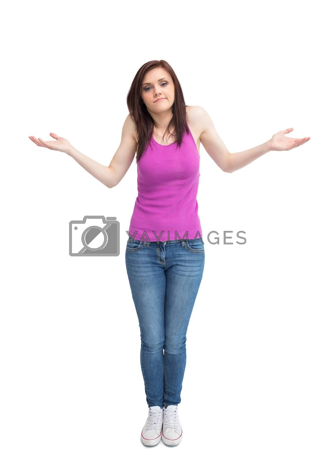 Uncertain attractive brunette posing by Wavebreakmedia