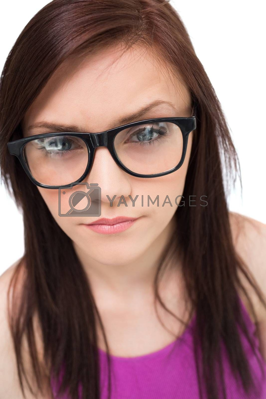 Close up on pretty brunette with glasses posing by Wavebreakmedia
