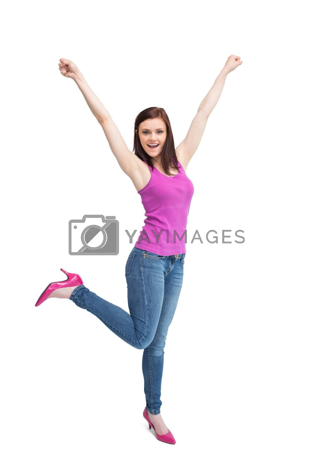Happy stylish brunette wearing high shoes cheering up by Wavebreakmedia