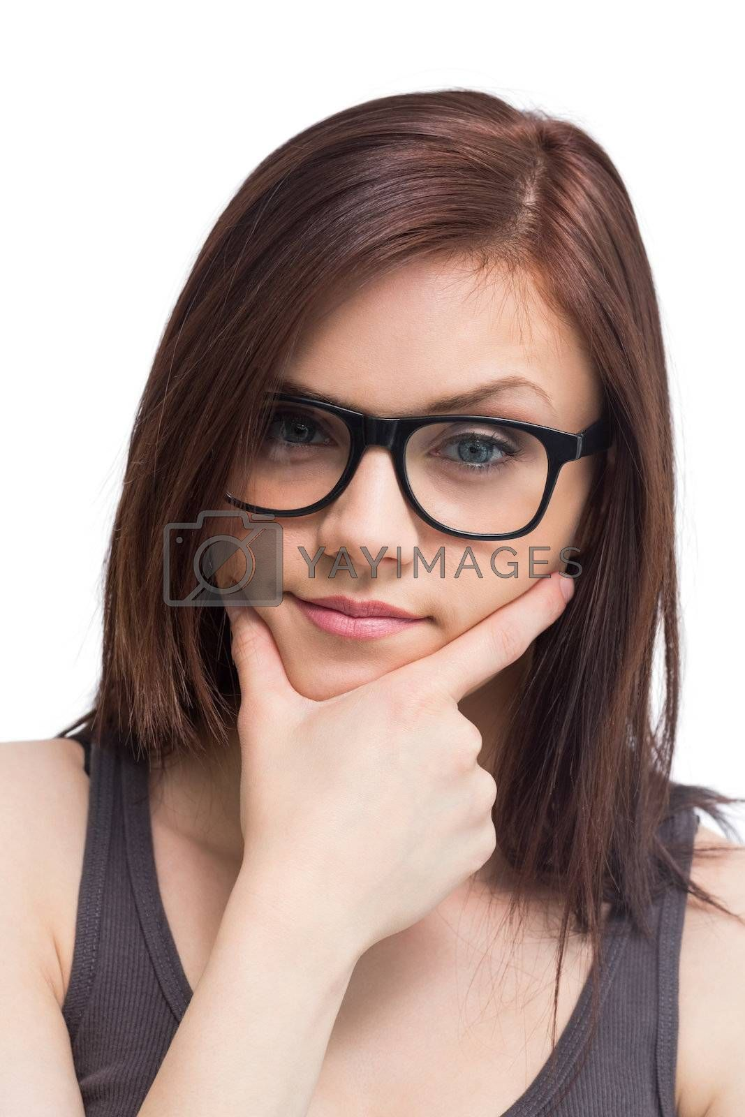 Thinking young woman wearing glasses posing by Wavebreakmedia