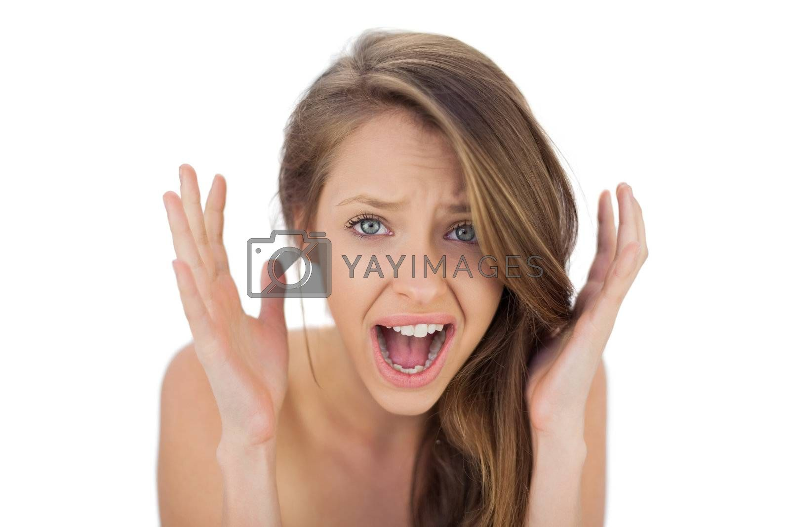 Annoyed brunette model raising her hands and screaming by Wavebreakmedia
