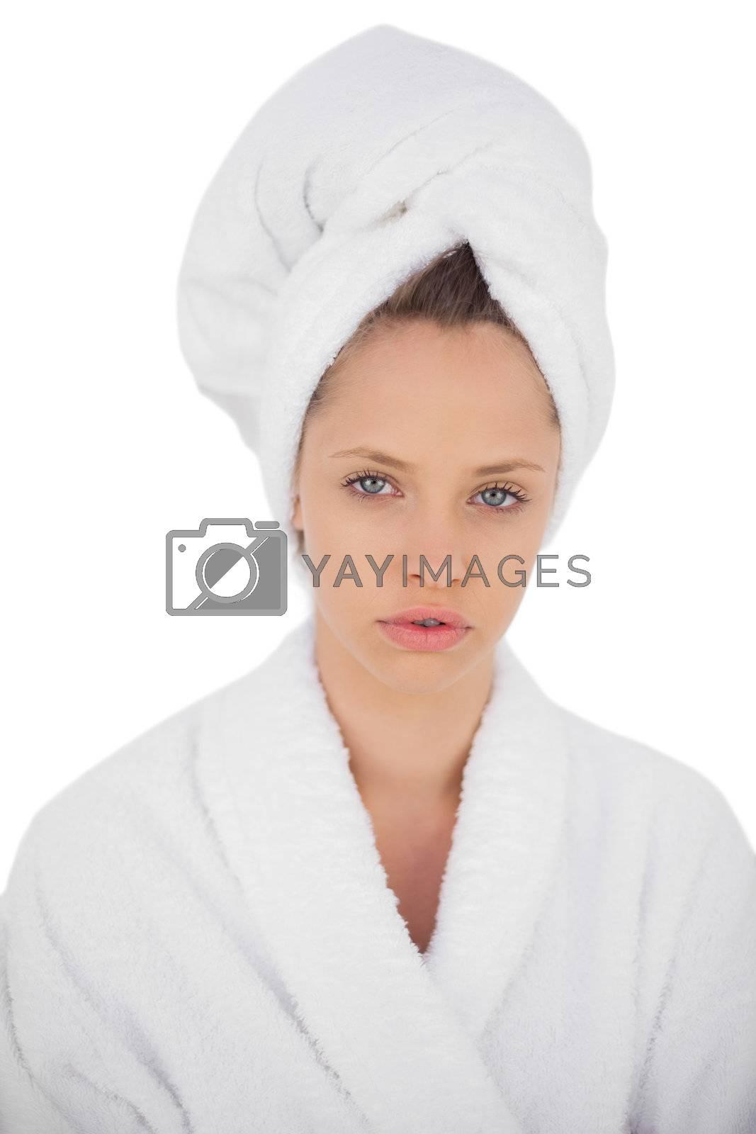 Serious brunette in bathrobe looking  by Wavebreakmedia
