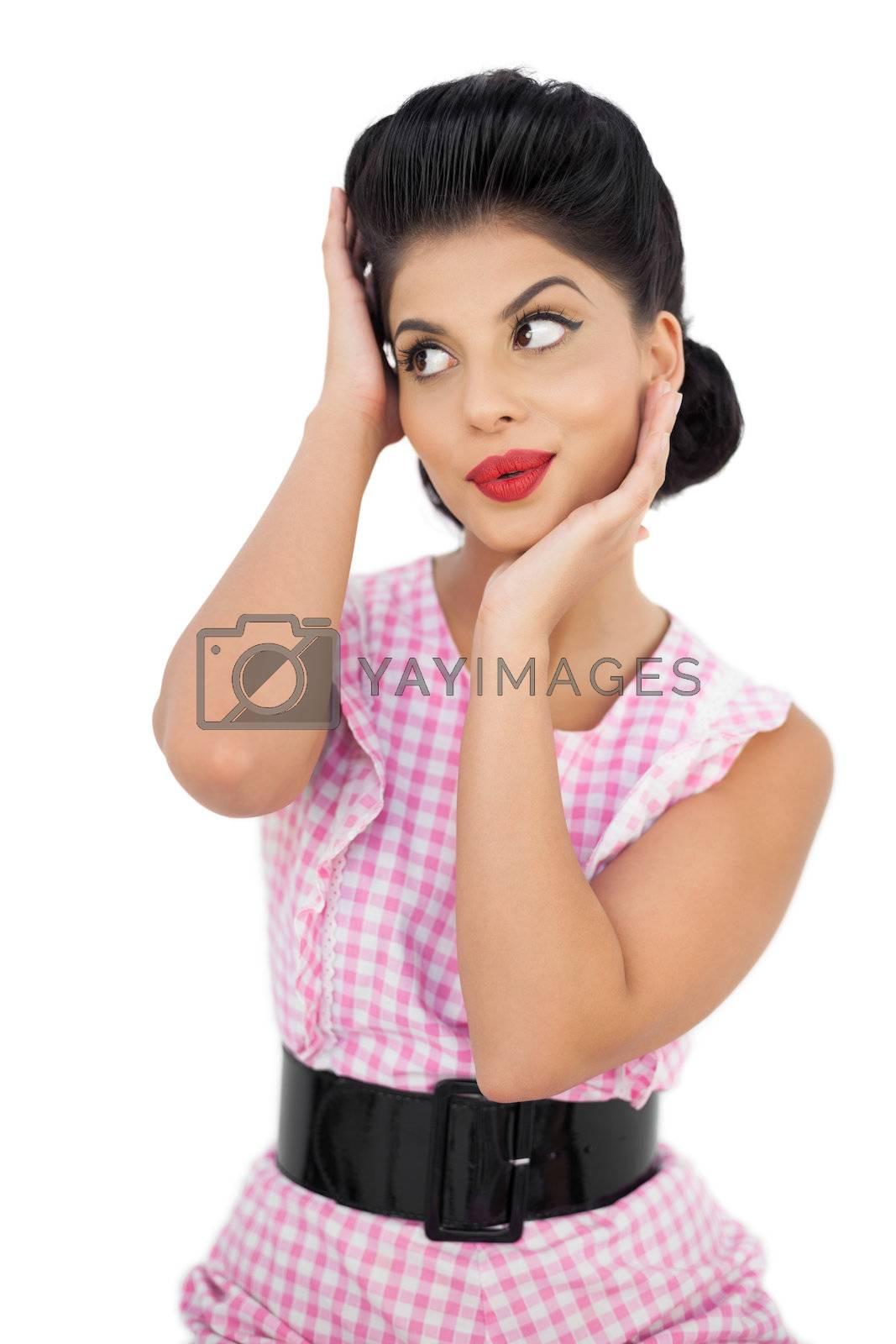 Attractive black hair model looking away by Wavebreakmedia