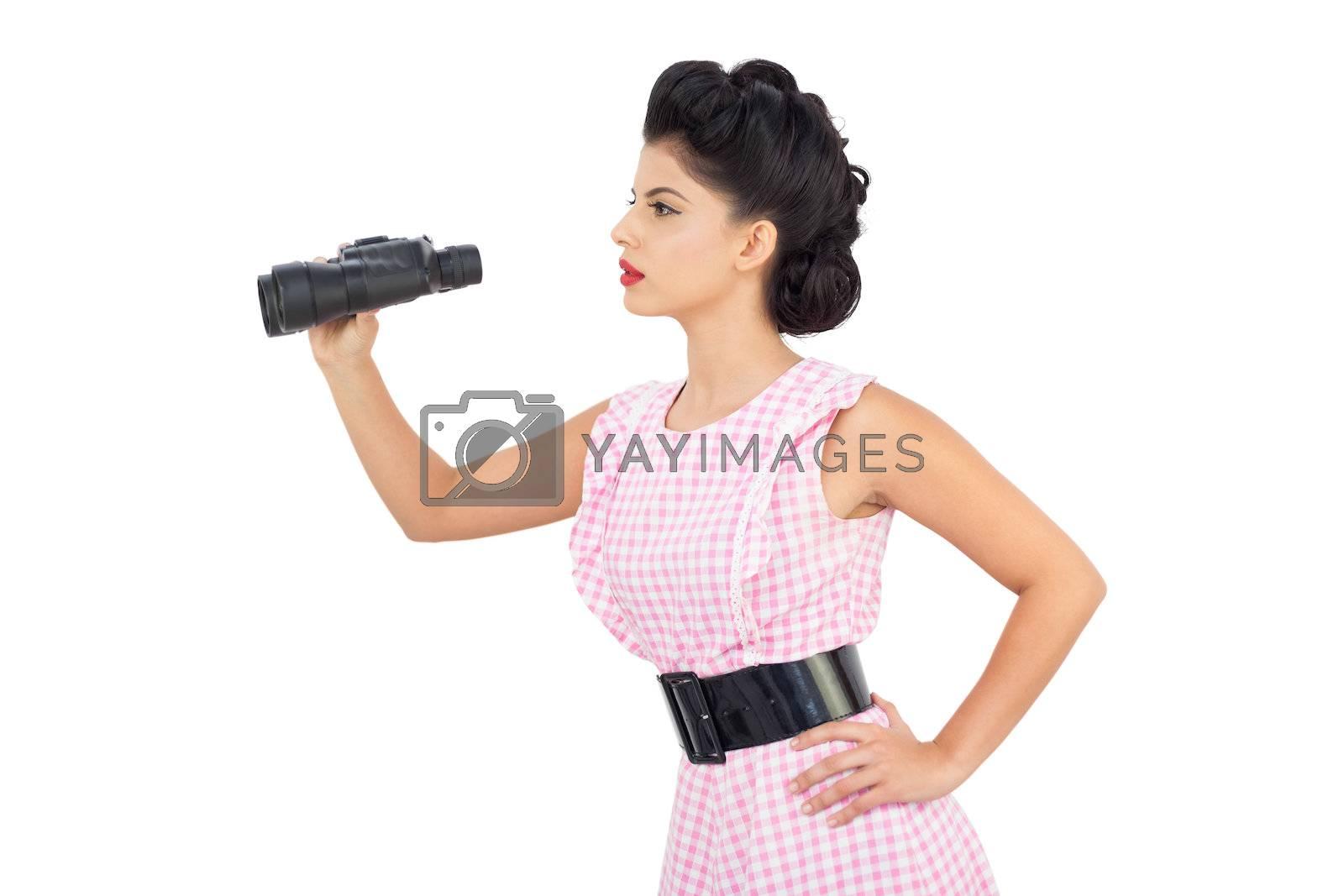 Attentive black hair model using binoculars by Wavebreakmedia