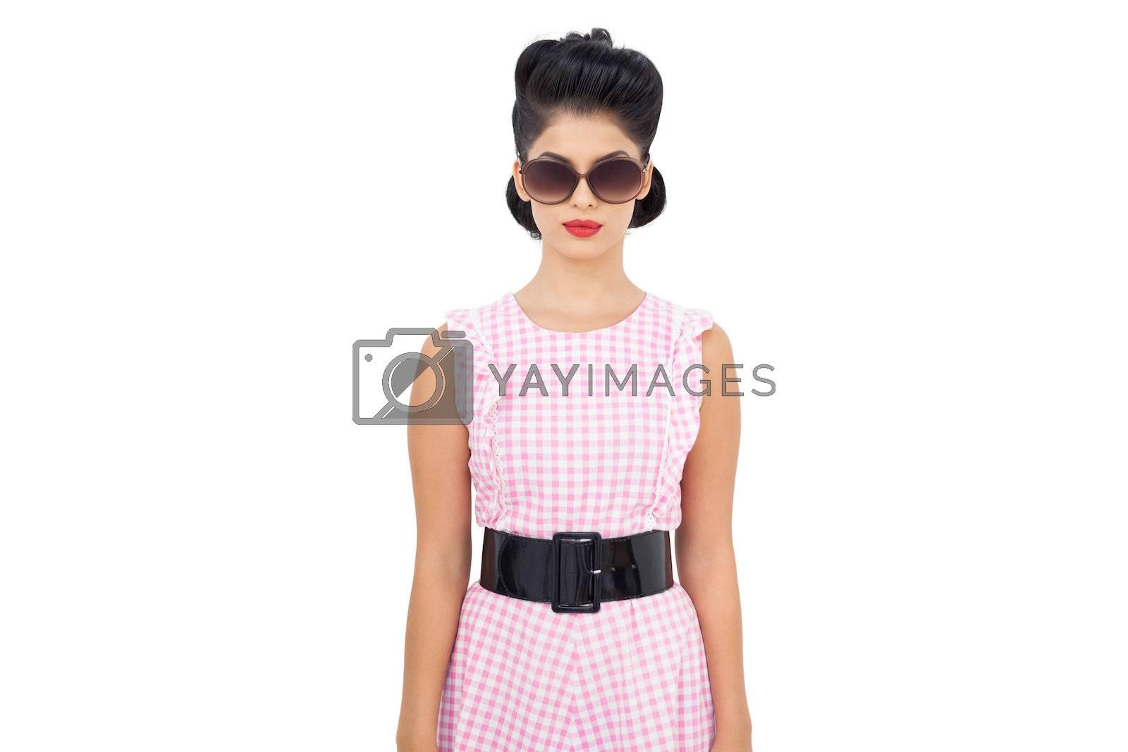 Serious black hair model wearing sunglasses by Wavebreakmedia