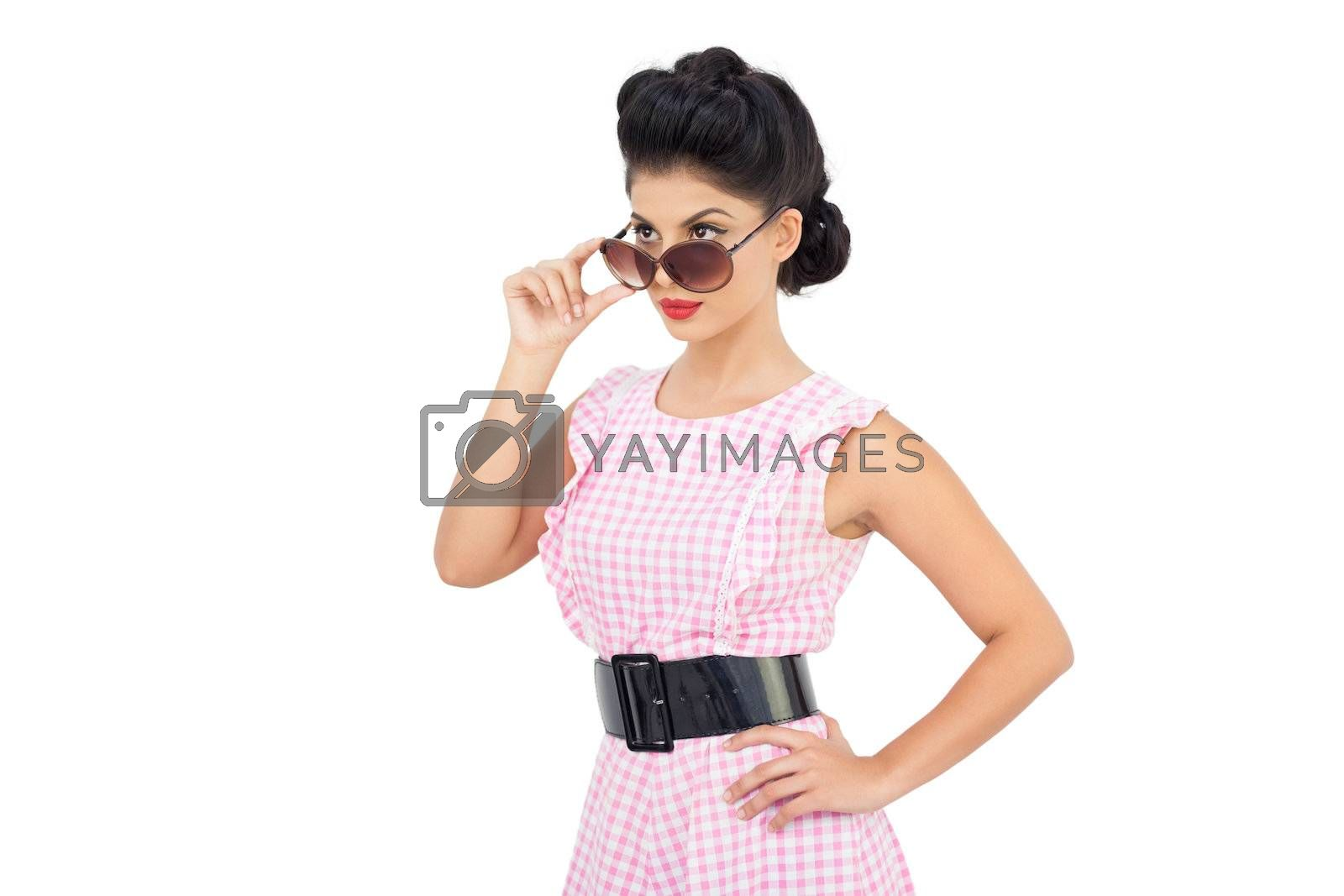 Charming black hair model looking over her sunglasses by Wavebreakmedia