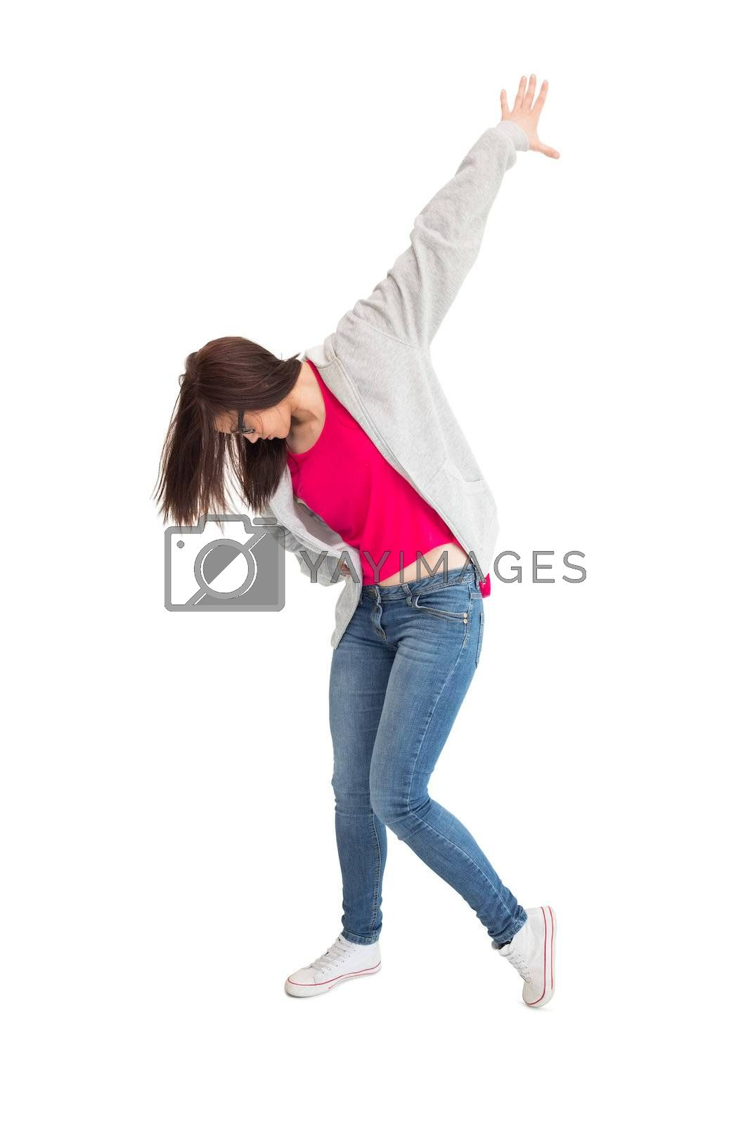 Trendy young woman dancing by Wavebreakmedia