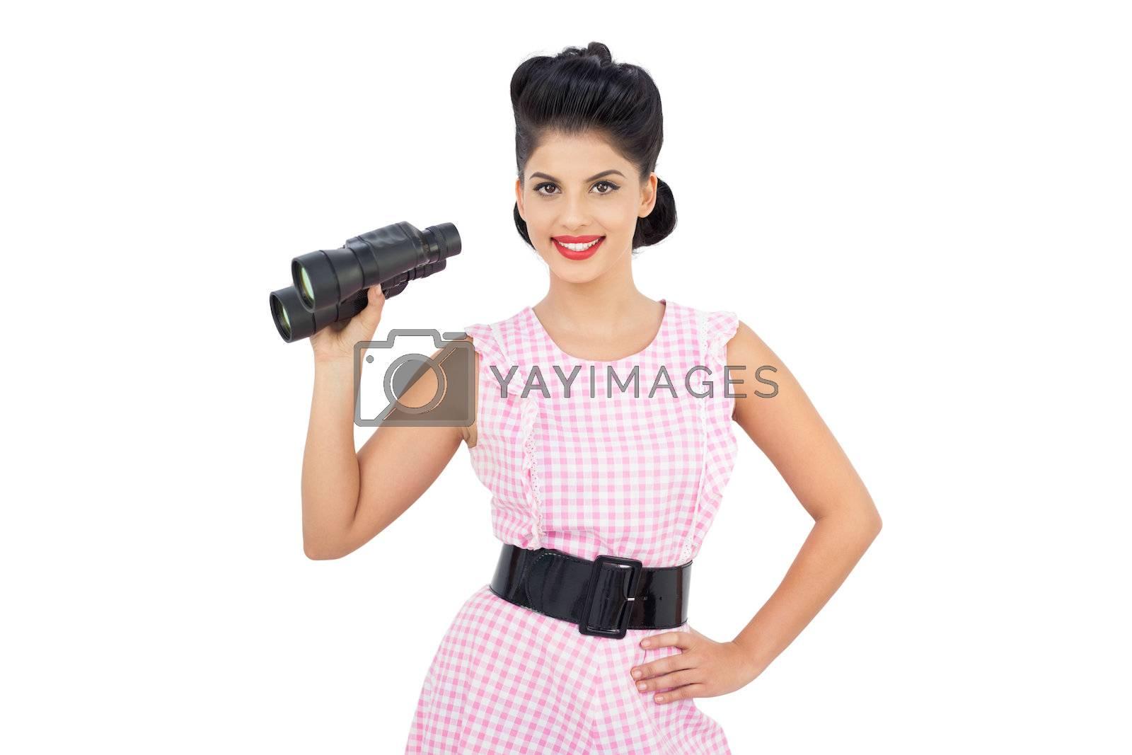 Delighted black hair model holding binoculars by Wavebreakmedia