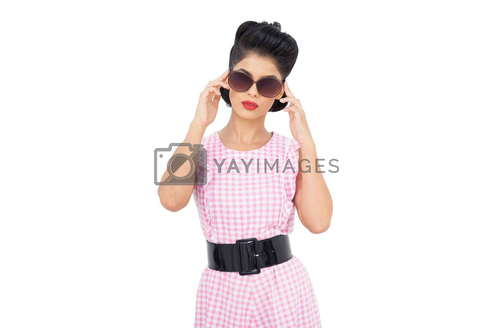 Concentrated black hair model wearing sunglasses by Wavebreakmedia