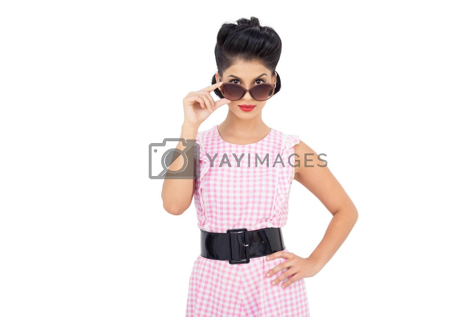 Pretty black hair model looking over her sunglasses by Wavebreakmedia
