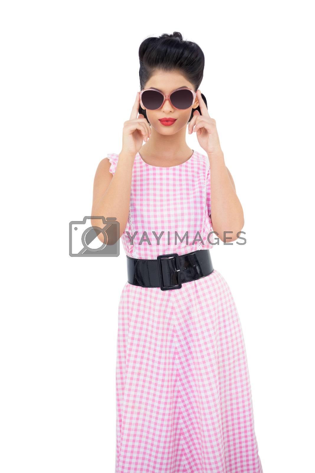 Wondering black hair model wearing sunglasses by Wavebreakmedia