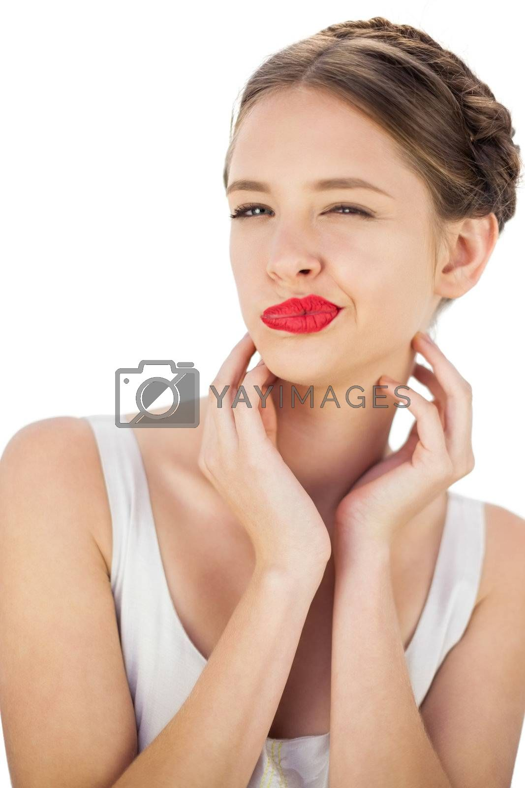 Charming model in white dress posing wrinking her nose by Wavebreakmedia