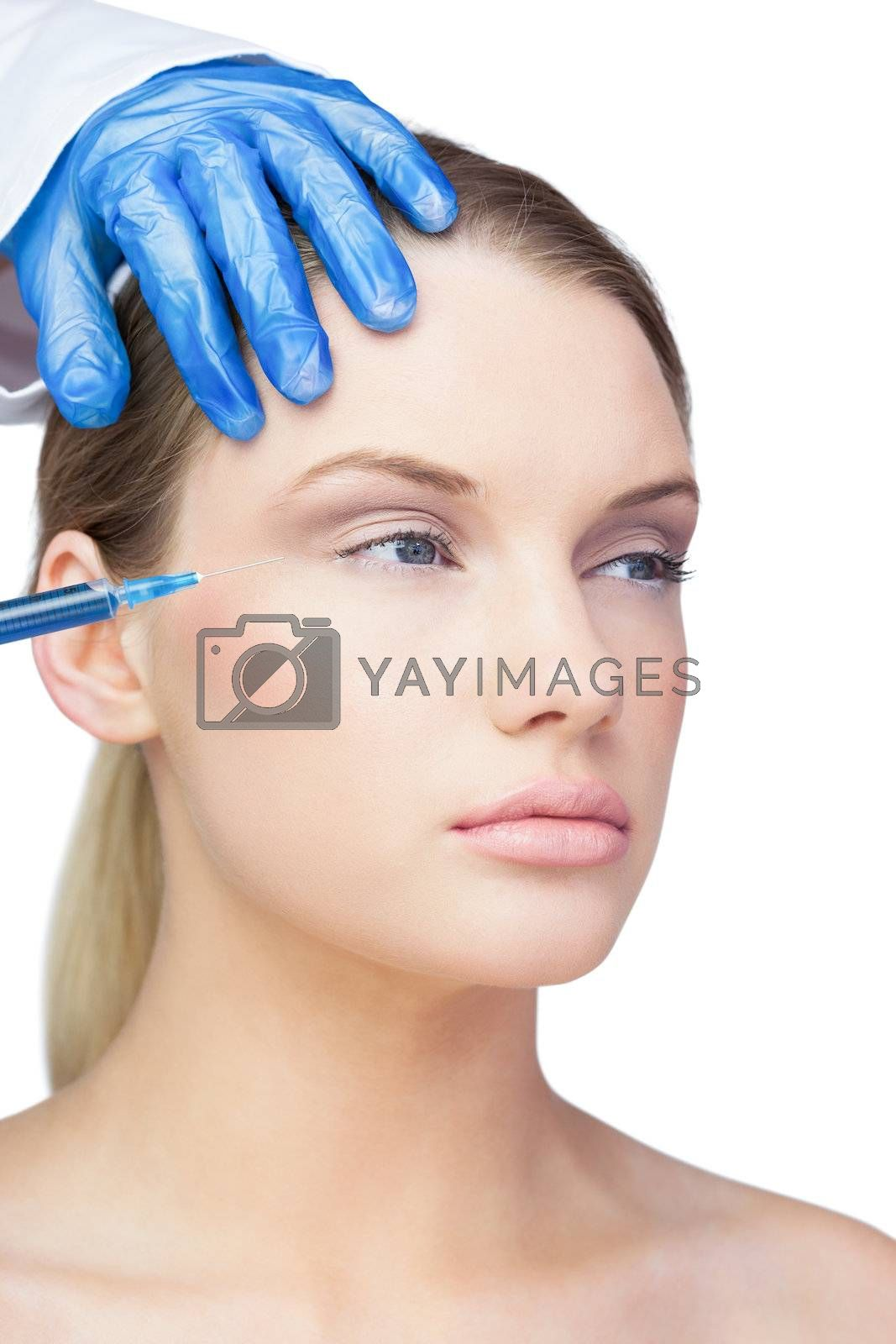 Calm young model having botox injection by Wavebreakmedia