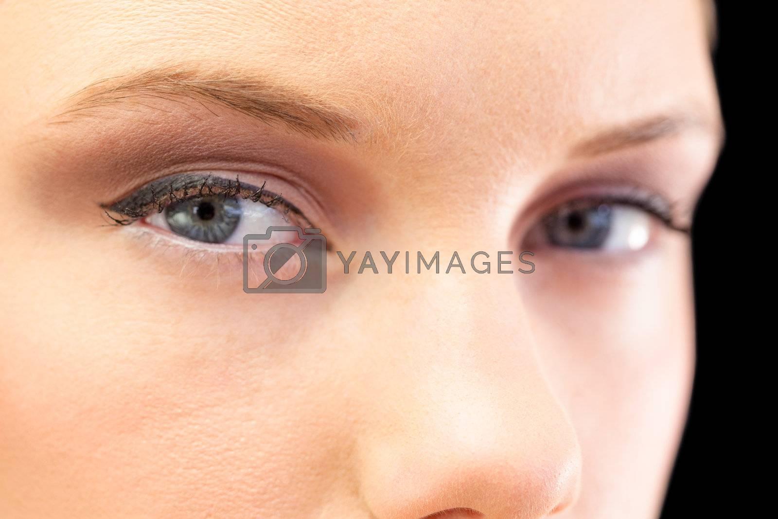 Close up on beautiful models blue eyes by Wavebreakmedia