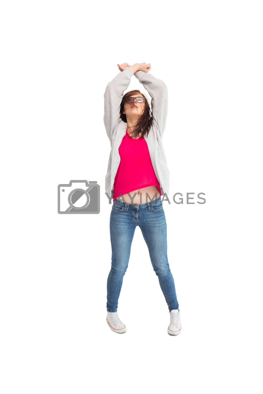 Pretty young woman dancing by Wavebreakmedia